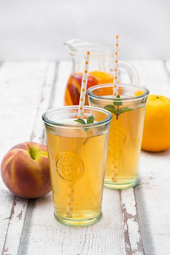 Two glasses of peach orange ice tea - gettyimageskorea