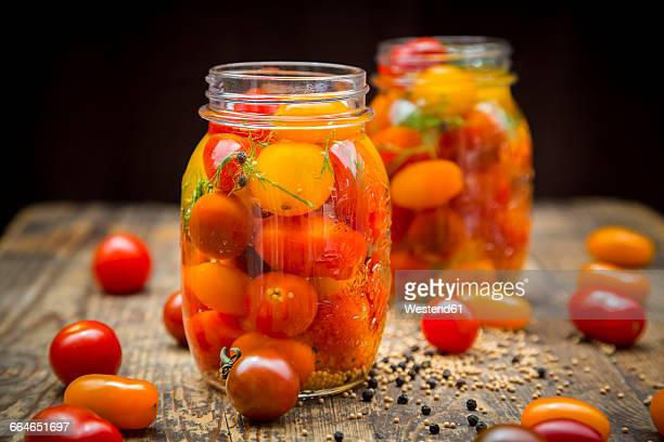 two glasses of pickled tomatoes - pickled stock pictures, royalty-free photos & images