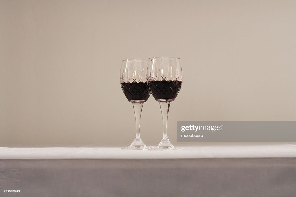 Two glasses of red wine on table : Photo