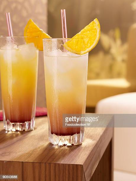 Two glasses of tequila sunrise on table, close up
