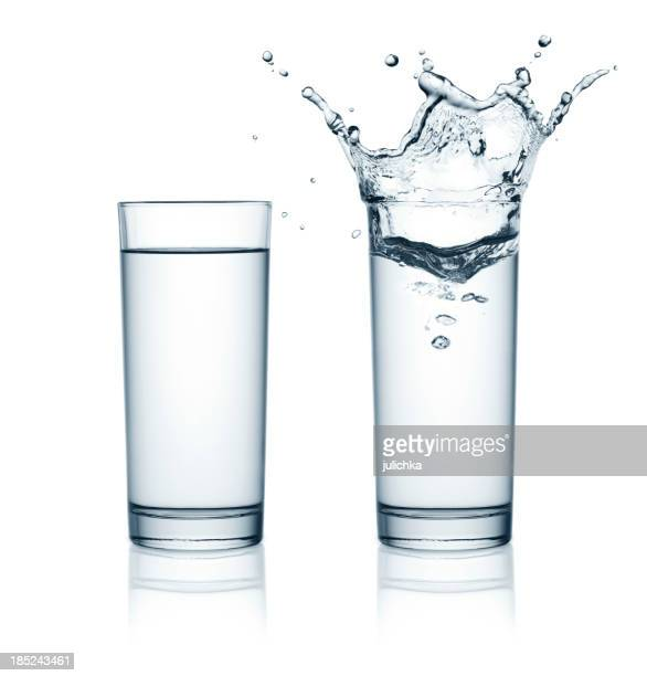 Two glasses of water, one with splashes