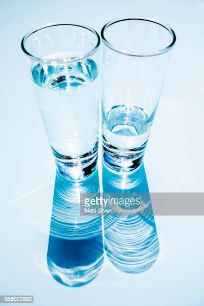 two glasses of water with shadow - 影のみ ストックフォトと画像