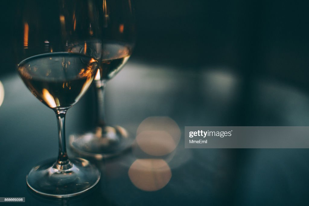 Two glasses of white wine on a table : Stock Photo