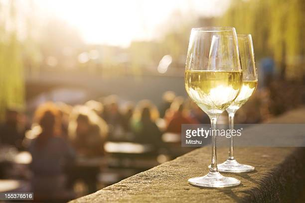 Two glasses of white wine on sunset