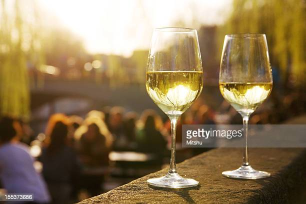 Two glasses of wine in an outside cafe