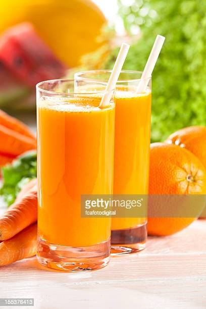 Two glasses with orange and carrot juice