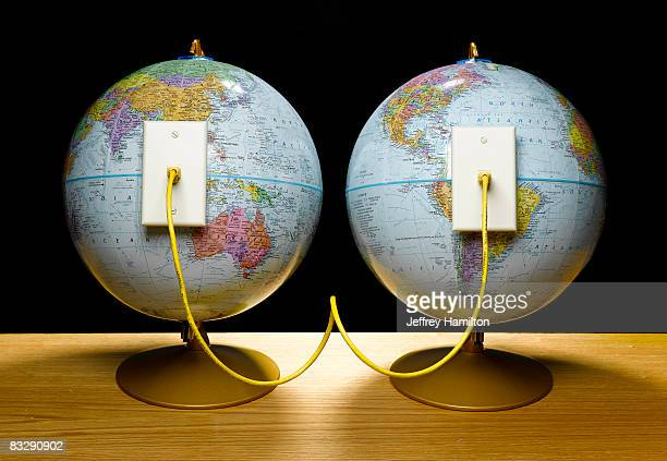 Two globes connected by ethernet cable