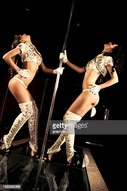 Two go-go dancers at a nightclub