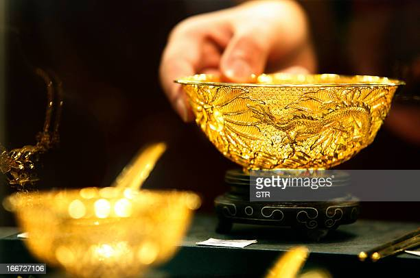 Two gold bowls are displayed in a shop in Huaibei, central China's Anhui province on April 16, 2013. Gold prices recovered slightly on April 16 after...