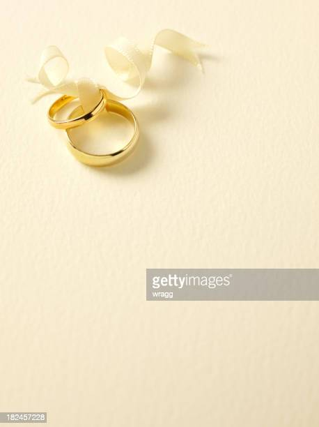 two gold wedding rings - wedding invitation stock pictures, royalty-free photos & images
