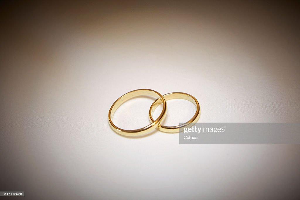 Two Golden Wedding Rings White Background Vignette