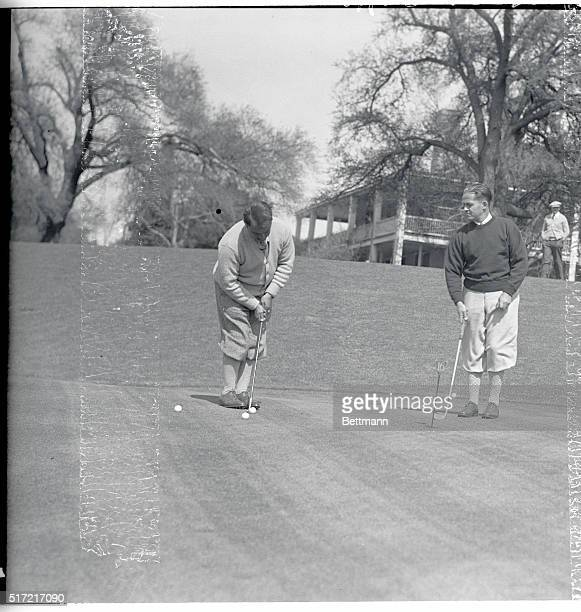 Two Golf Masters Exchange Putting Ideas Augusta Georgia Bobby Jones whose putter Calamity Jane has proved the deciding factor in many a tournament...