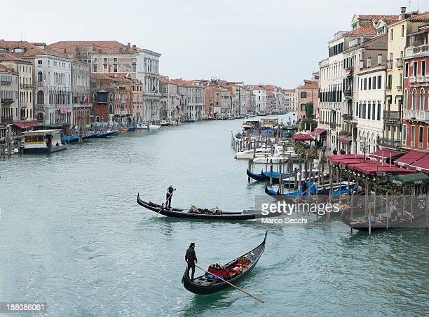 Two gondola manouvers along an unusually empty Grand Canal around the Rialto area during the third day of strike by the transporters on November 15,...