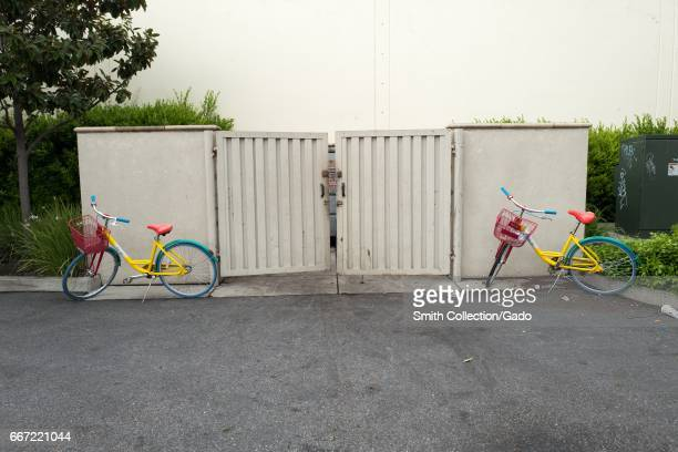 Two Google bikes are haphazardly parked near a garbage dumpster near the Googleplex the Silicon Valley headquarters of search engine and technology...