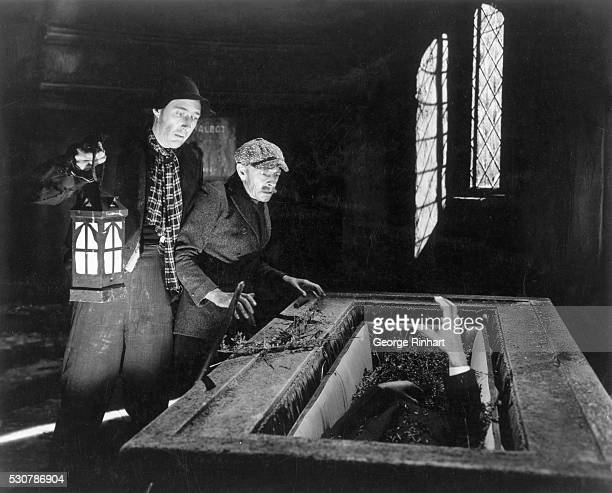 1943 Two grave robbers in the Talbot Mausoleum are frozen in their tracks as the corpse Larry actor Lon Chaney Jr comes to life in the stone coffin...