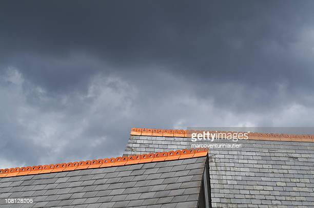 Two Gray Rooftops, Red Detail on dramatic sky - copyspace