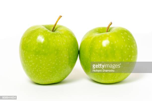 two green apples - two objects stock pictures, royalty-free photos & images