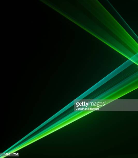 two green laser strips of light - zonnestraal stockfoto's en -beelden