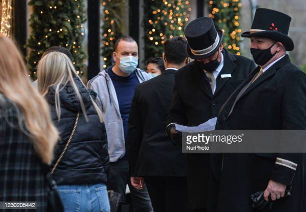 Two greeters wearing face masks seen filtering customers at the entrance of Brown Thomas department store on Grafton Street in Dublin. On Friday,...