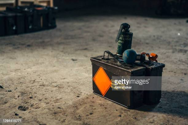two grenades on a metal ammunition box - explosive stock pictures, royalty-free photos & images
