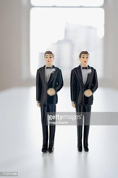 Two groom wedding cake figurines