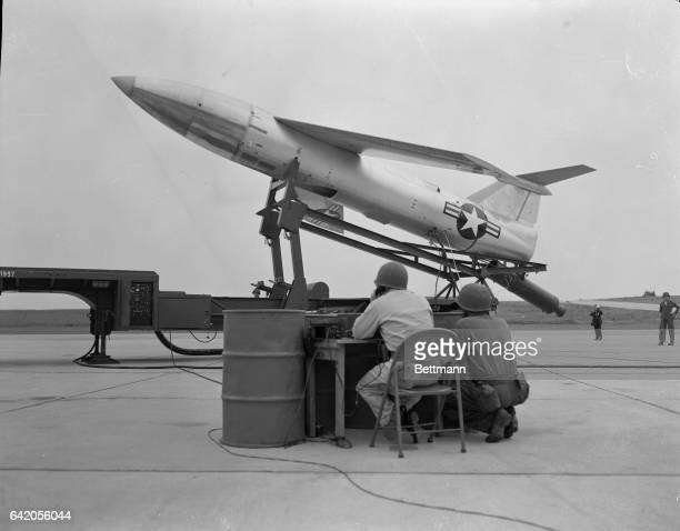 Two ground crewman of the 1st Pilotless Bomber Squadron stationed in the West German Eifel Mountains demostrate the procedure for starting on eof the...