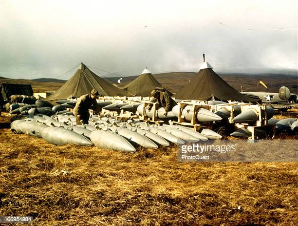 Two grounds crewmen log a shipment of drop fuel tanks for use on fighte planes in the Aleutian Islands Campaign early 1940s Once they are expended...