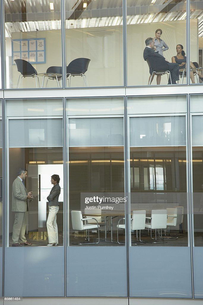 Two groups of business people having a meeting : Stock-Foto