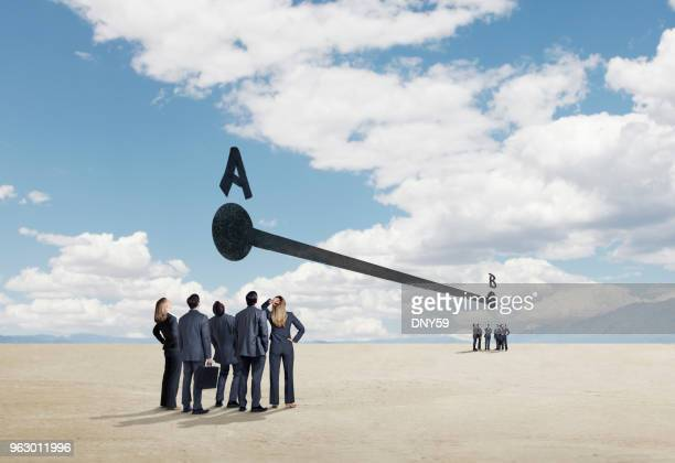 two groups of businesspeople trying to get from point a to point b - letra b imagens e fotografias de stock