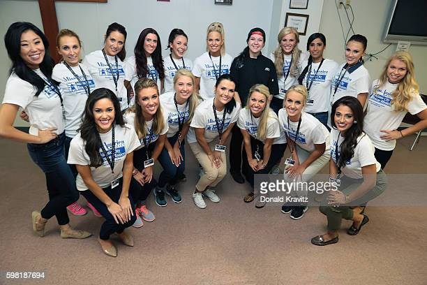 Two groups of Miss America 2017 Contestants pose for photo with Chef before providing assistance to the Atlantic City Rescue Mission on August 31...