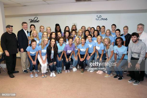 Two groups of Miss America 2018 Contestants pose for a photograph with Savvy Shields Miss America 2017 members of the National Staff of The Miss...