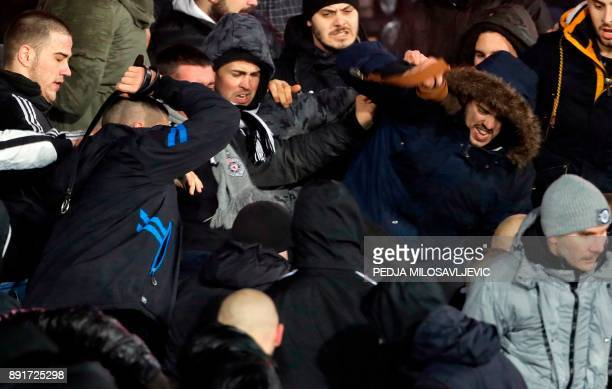 Two groups of Partizan Belgrade's supporters clash during the Serbian Superleague derby football match between Partizan Belgrade and Crvena Zvezda on...