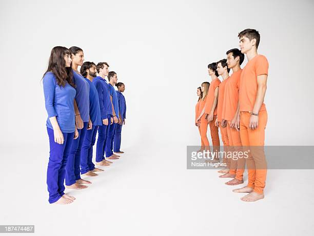 two groups of people in rows - face off stock pictures, royalty-free photos & images