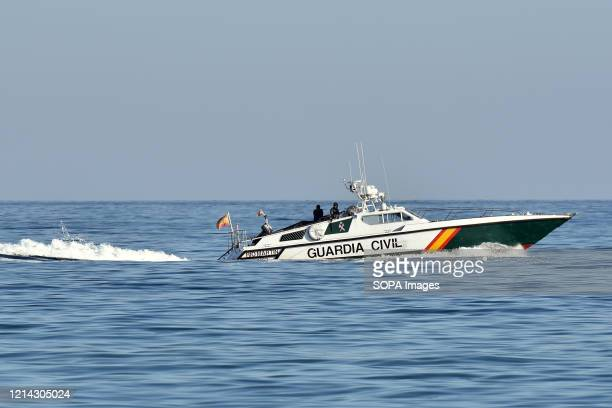 Two Guardia civil police officers on a motor boat patrolling the coast to enforce the rules during the final confinement of Phase One Calafell is in...