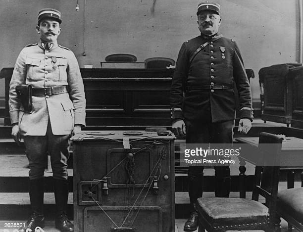 Two guards stand next to the oven in which murderer Henri Desire Landru was supposed to have burned his victims' bodies Known as the French...