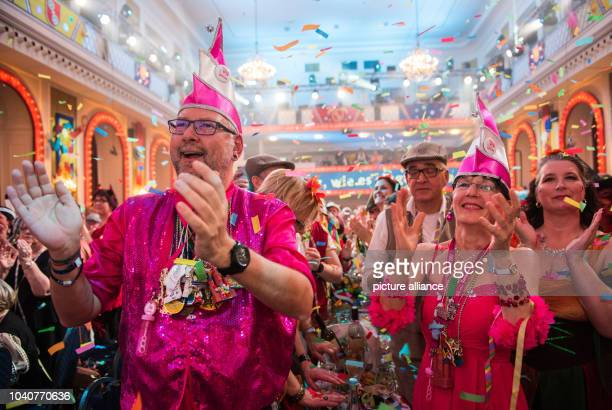 Two guests dressed up in pink clap during a dress rehearsal of the 'Mainz bleibt Mainz' show in Mainz Germany 22 February 2017 The Carnival special...