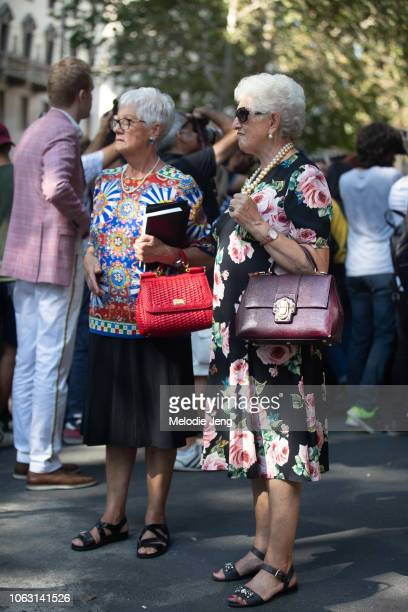 Two guests outside the Dolce Gabbana show during Milan Fashion Week Spring/Summer 2019 on September 23 2018 in Milan Italy