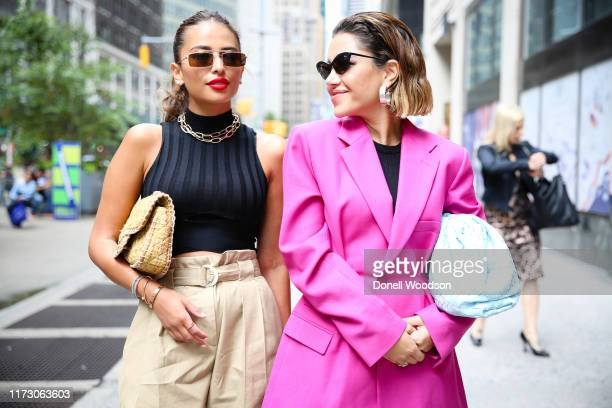 Two guests pose during New York Fashion Week at Gotham Hall on September 07, 2019 in New York City.