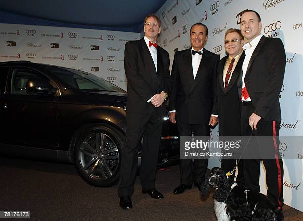 Two Guests with Sir Elton John David Furnish and Arthur their English Cocker Spaniel In the background is the Audi Q7 that will be auctioned off at...