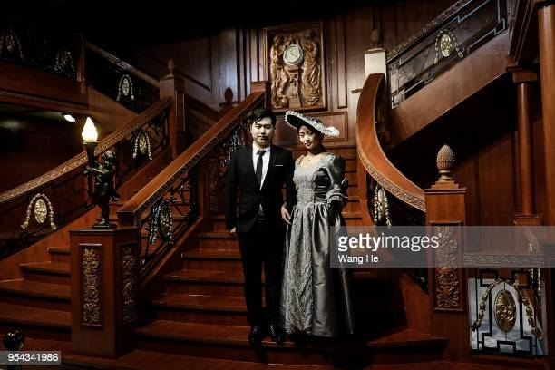 """Two guide poses in replica of the Titanic's """"Grand Staircase"""" during the """"Titanic the Artifact Exhibition,"""" at Hangu art Gallery on May 3, 2018 in..."""