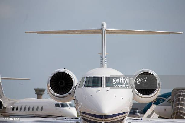 Two Gulfstream Aerospace Corp business jets move along a taxi way before positioning at a static display location during preparations ahead of...