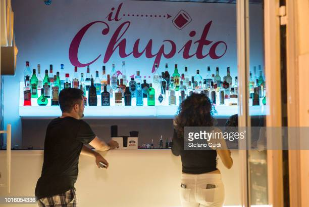 Two guys into a Il Chupito a shot drink club during the nightlife in the Via Marina The Via Marina of Reggio Calabria consists of the four streets...
