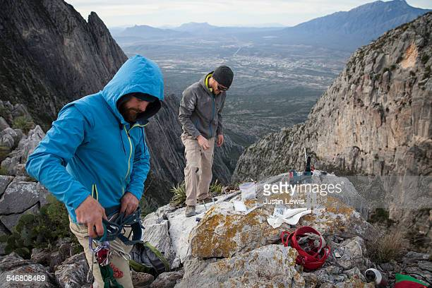 Two Guys Prepare Gear for Rock Climbing