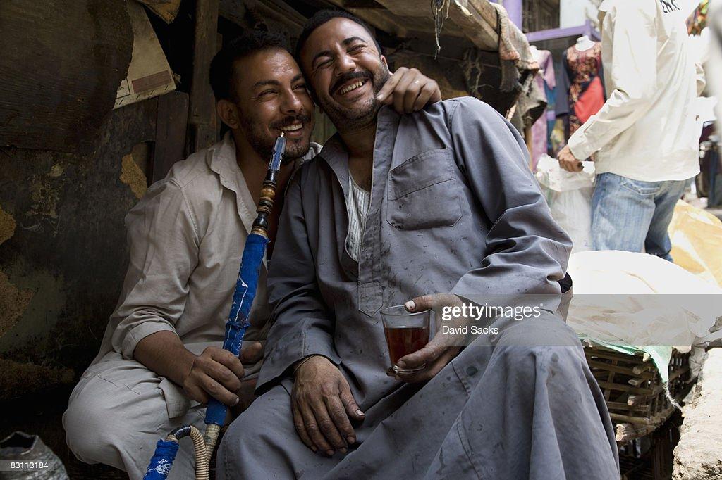 two guys smoking pipe : Stock Photo