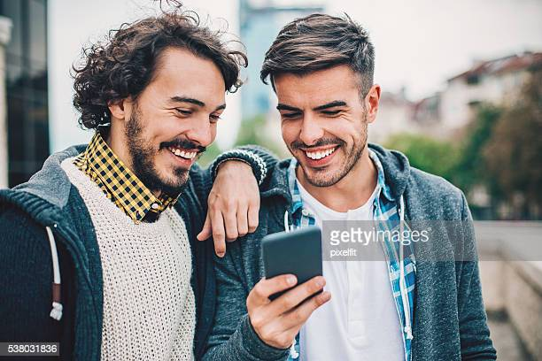 Two guys with smart phone
