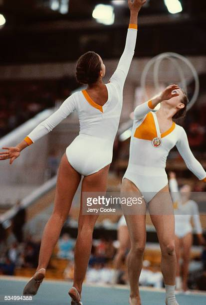 Two gymnast practice before the rhythmic gymnastics competition at the 1980 Summer Olympics