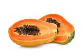two half cut of ripe papaya with seeds isolated on white background