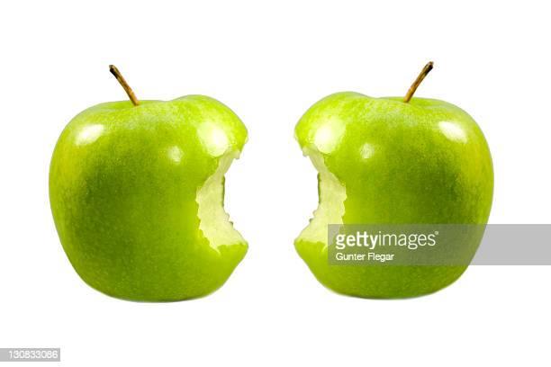 Two half-eaten apples Granny Smith