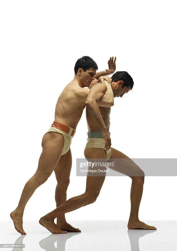 Two half-nude men wrestling : Stockfoto