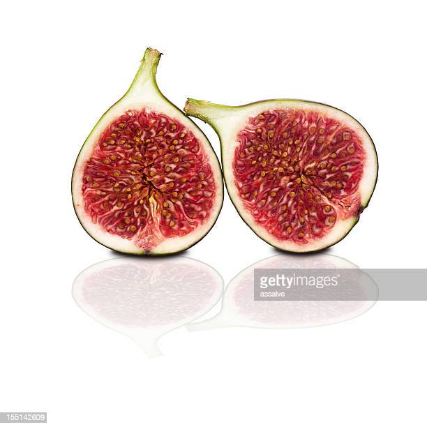 two halves of figs isolated on white background